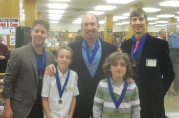 The author (center) and his sons with With IDW editor-in-chief Chris Ryall & Age of Bronze illustrator Eric Shanower